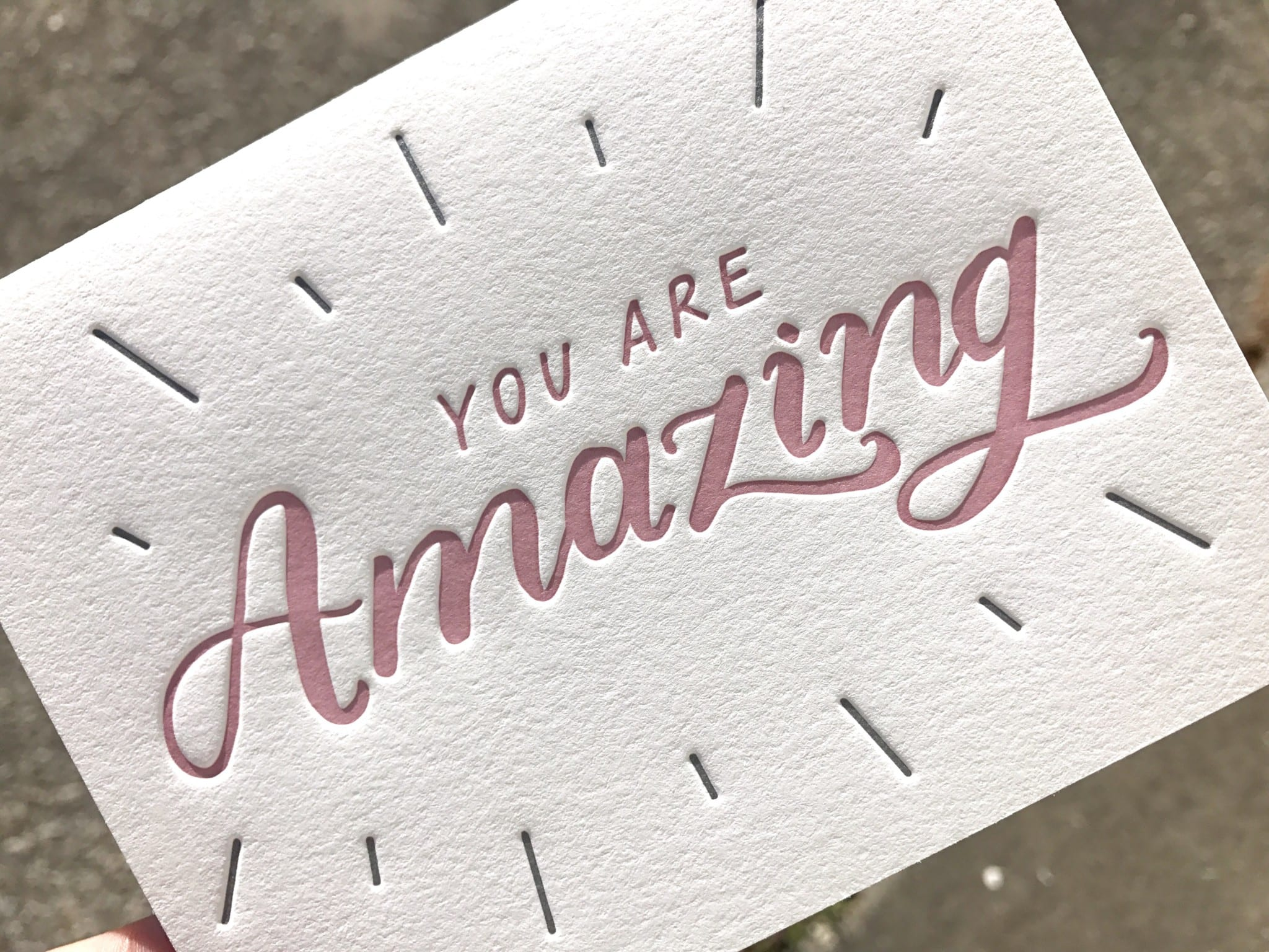 You Are Amazing handlettering letterpress-printed into 100% cotton paper showing depth of impression.